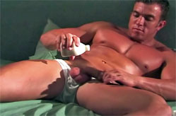 Muscled guy gets hard